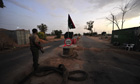 A Libyan NTC fighter mans a checkpoint near the coastal city of Misrata