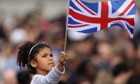 A young girl waves the Union flag