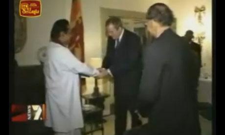 Adam Werritty shaking Mahinda Rajapaksa's hand