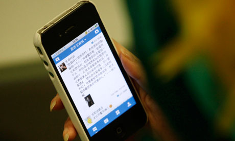 A woman reads a blog on her iPhone
