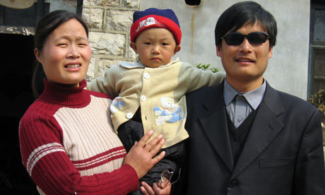 Blind activist Chen Guangcheng with his wife and son in Shandong 2005