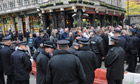 Police officers move in on suspected EDL members at the Red Lion pub in Whitehall, London
