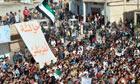 Demonstrators protest against the Syrian president, Bashar al-Assad, in Hula, near Homs