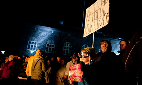 Protesters demonstrate in front of the Icelandic parliament