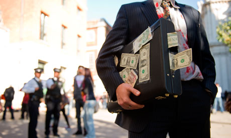 http://static.guim.co.uk/sys-images/Guardian/Pix/pictures/2011/11/15/1321355971086/A-man-dressed-as-a-banker-007.jpg