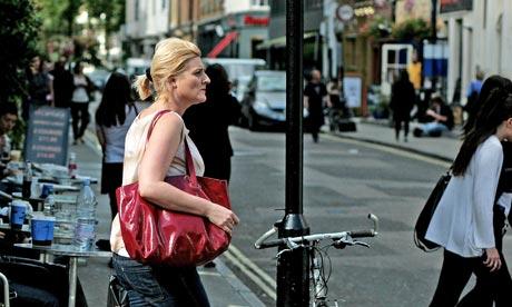 People walking on Old Compton Street in Soho, London