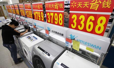 A customer inspects washing machines at a supermarket in Wuhan, China