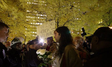 Occupy Wall Street protesters return to Zuccotti Park with strict police-enforced rules