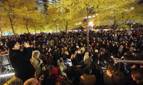 Occupy Wall Street protesters attend a general assembly meeting after re-entering Zuccotti Park