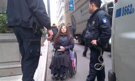 Police arrested a woman in a wheelchair at the Occupy Wall Street protests in New York