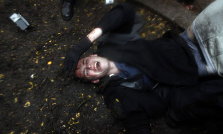 Occupy Wall Street protester Brandon Watts lies injured on the ground after clashes with police over the eviction of OWS from Zuccotti Park. Photograph: Allison Joyce/Getty Images