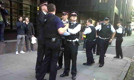Police outside occupied UBS building in London on 18 November 2011.