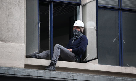 An Occupy London protester in the occupied UBS building in London on 18 November 2011.