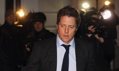 Hugh Grant leaves court after giving evidence to the Leveson inquiry