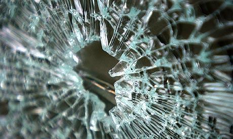 A broken glass panel close up