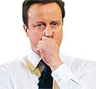 British Prime Minister David Cameron (C)