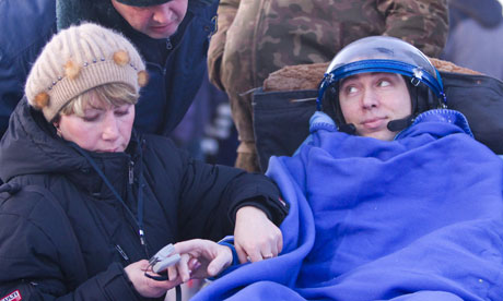 Sergei Volkov shortly after emerging from the Soyuz capsule