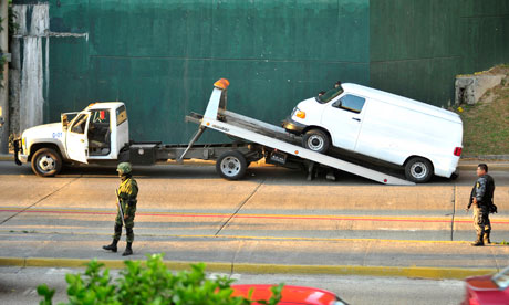 Van with dead bodies being towed away