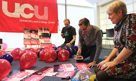 Staff at the University and College Union prepare placards for Wednesday's public sector strike