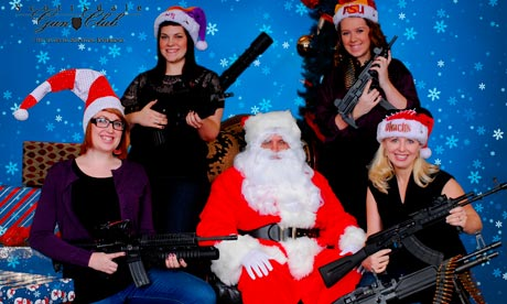 Scottsdale Gun Club members posing with Santa Claus and several guns