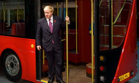 Boris Johnson stands on the platform of the new bus for London