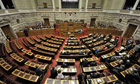 Greek deputies debate during a confidence vote at the Greek parliament in Athens on Friday.