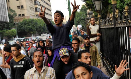 Egyptian protesters chant slogans agains the ruling military