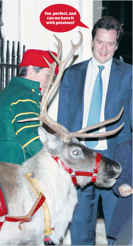 Chancellor George Osborne meets a reindeer in Downing Street.