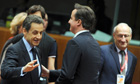 Nicolas Sarkozy and David Cameron in Brussels