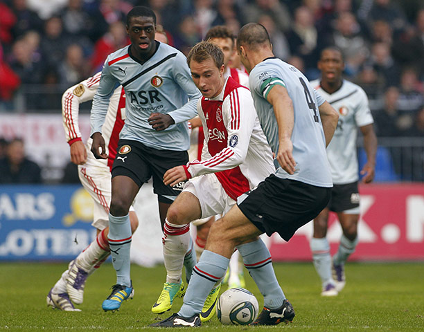 Man Utd targets: Ajax's Christian Eriksen is closed down by Ron Vlaar and Bruno Martens Indi