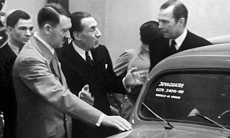 Louis Renault (centre) with Adolf Hitler and Hermann Göring at the Belin auto show in 1937