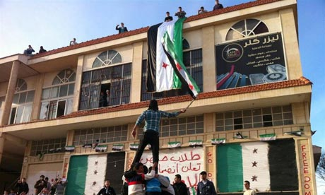 Demonstrators against Syria's President Bashar al-Assad gather in Homs