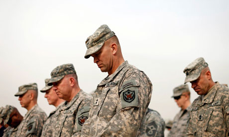 Soldiers lower their heads at encasing ceremony Baghdad