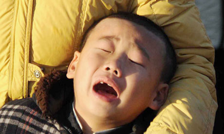 A North Korean child is overcome by grief at the death of Kim Jong Il