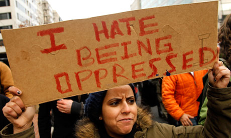 A demonstrator holds a sign in Washington as part of the Occupy Wall Street protests, November.