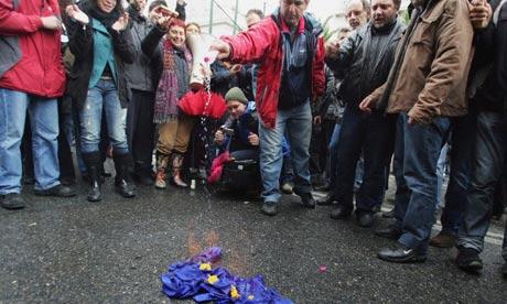 Demonstrators burn an EU flag in Athens