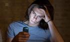 A man reading a text message