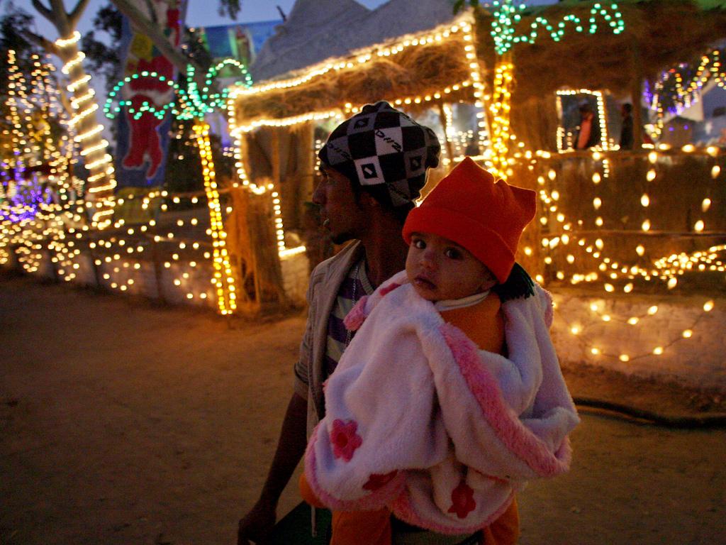Pakistani Christians look at decorations