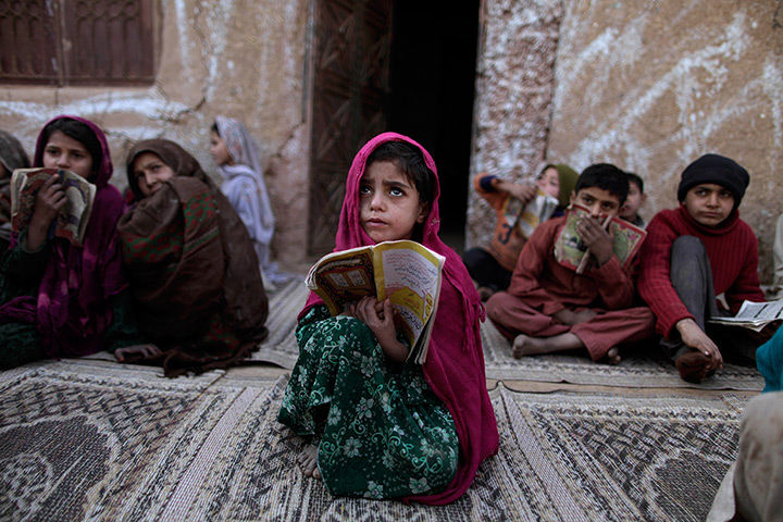 24 hours in pictures: a girl in a pakistani madrassa