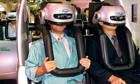 Japanese men enjoying virtual reality driving. Photograph: Kazuhiro Nogi/EPA