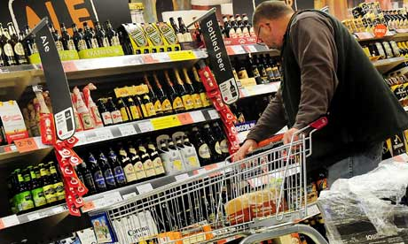 A customer looks at alcohol on the shelf in a supermarket in Burton-on-Trent