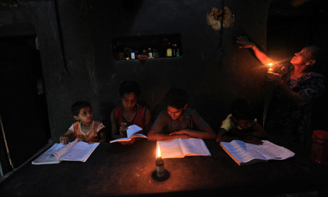 Indian children studying by candlelight