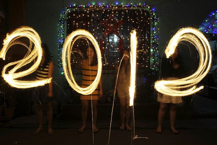 New Year celebrations: Women spell out 2012 with sparklers