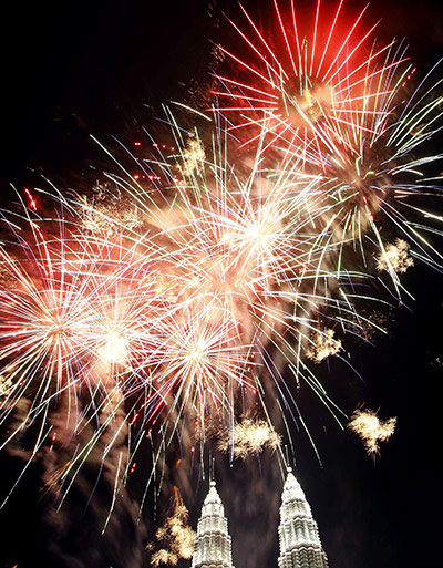 New Year celebrations: Malaysia: Fireworks explode above the Petronas Towers in Kuala Lumpur