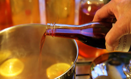 Making mulled cider - in goes the sloe gin
