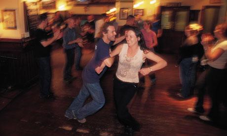 Dancers enjoy an energetic reel at a ceilidh night