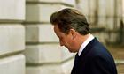 David Cameron leaves Downing Street