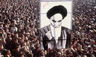 Iranian protesters hold up a poster of Ayatollah Khomeini during revolution that deposed the Shah