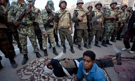 Army trys to clear away protesters in Tahrir Square