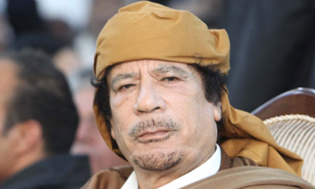 Libyan leader Muammar Gaddafi prays during a ceremony marking the birth of Islam's Prophet Mohammed